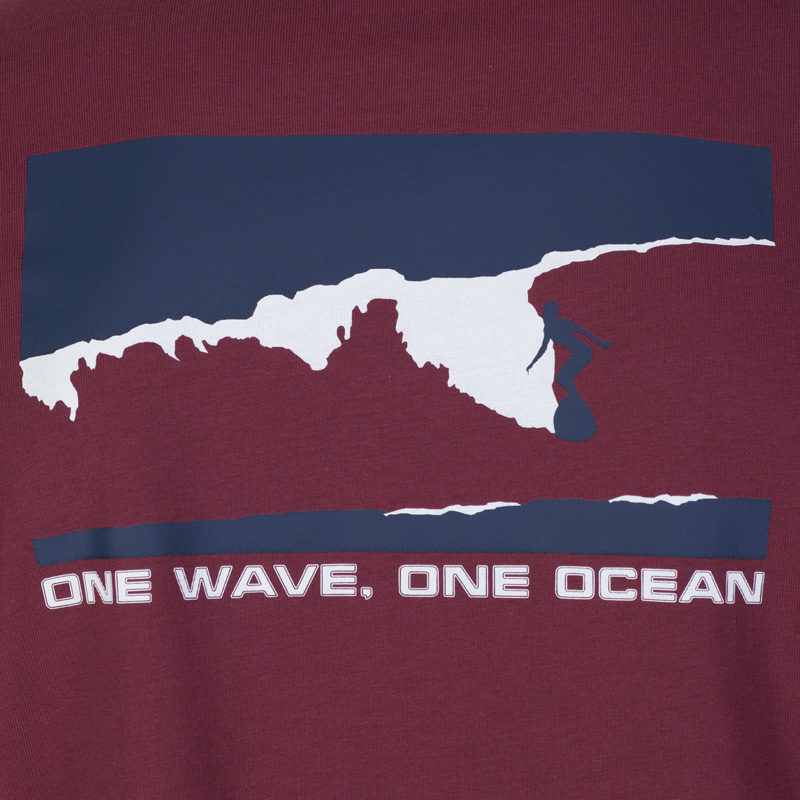 Close up of the raisin T-shirt with the navy and white surf and spiritual graphic that says 'one wave, one ocean.'