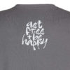 Detail of 'get free & be happy,' print on the Sanskrit mantra inspired T-shirt Lokah Samastah Sukhino Bhavantu