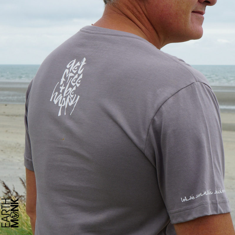 Detail of the fossil grey, Sanskrit inspired T-shirt with the words Lokah Samastah Sukhino Bhavantu printed on the sleeve as well as the words 'get free & be happy' printed on the back neck.